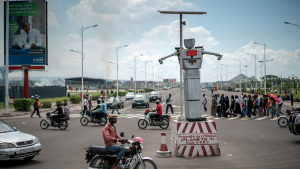 """Solar-powered robotic traffic cops have been """"hired"""" to regulate the disorderly traffic in Kinshasa, the capital of the Democratic Republic of Congo."""