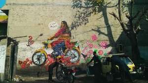 In Rawalpindi, the collective painted Bubbli Mallik, a Khwaja-sira (transgender person) riding a motorcycle.