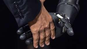 Robotic arm shakes hand