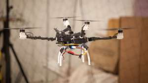 "A four-rotor ""bunnycopter"" developed at MIT's Computer Science and Artificial Intelligence Laboratory features propellers at different heights.  Photo: Jason Dorfman/MIT CSAIL"