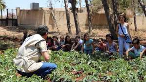 Nutrition education is key. School children and FAO staff discuss nutrition at a school garden in Hama, Syria. ©FAO/Wajdi Skaf
