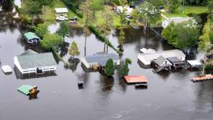An aerial view taken from a Coast Guard helicopter showing the continuing effects of flooding caused by Hurricane Joaquin in the area of the Black River, in Sumpter County, S.C., Oct. 6, 2015. U.S. Coast Guard photo by Petty Officer 1st Class Stephen Lehmann