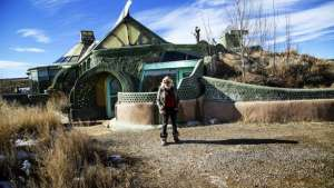 """Meet the Earthship"" is a short film about an off-grid community living in houses made of rubbish outside of Taos, New Mexico."